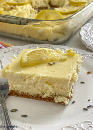 lemon lavender cheesecake slice on plate with fork