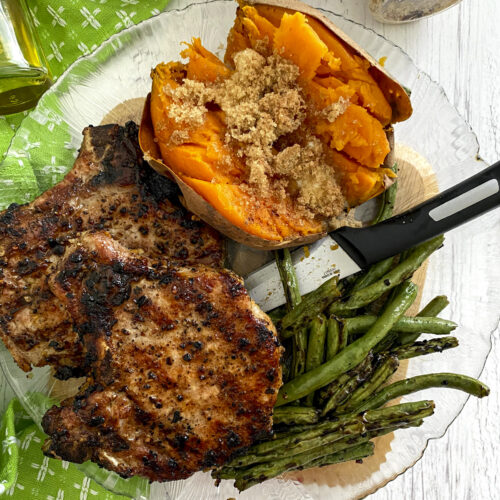 grilled pork chops on a plate