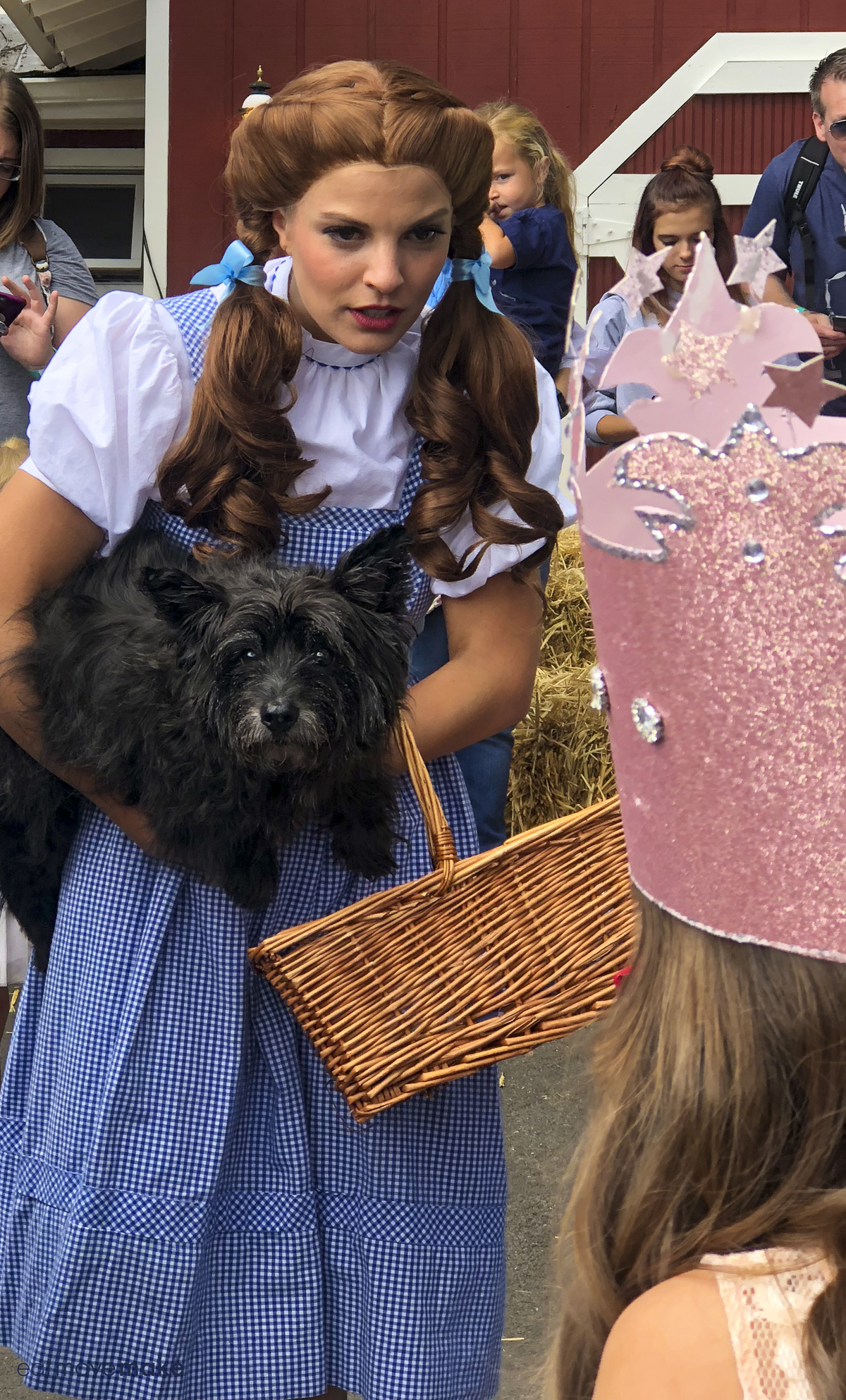 Dorothy and Toto talking to child
