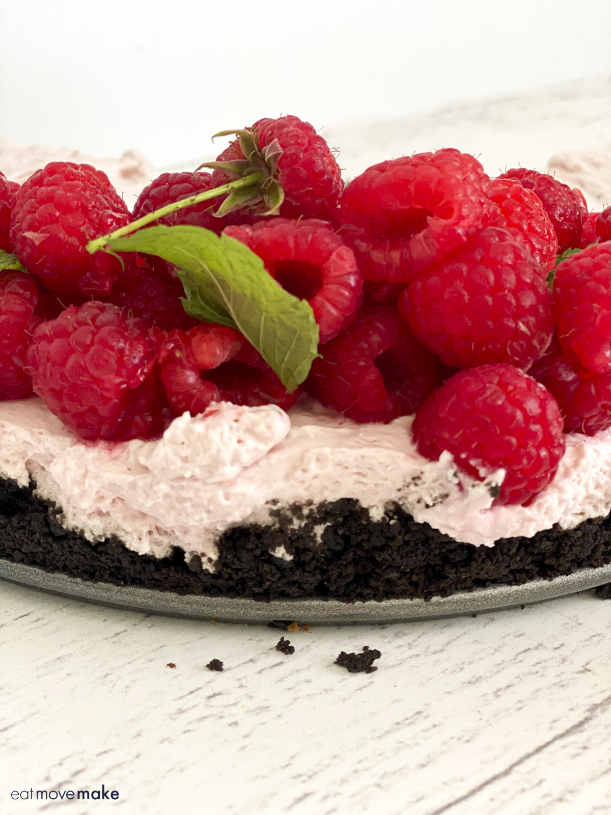 close-up of side of raspberries on top of filling on top of chocolate crust