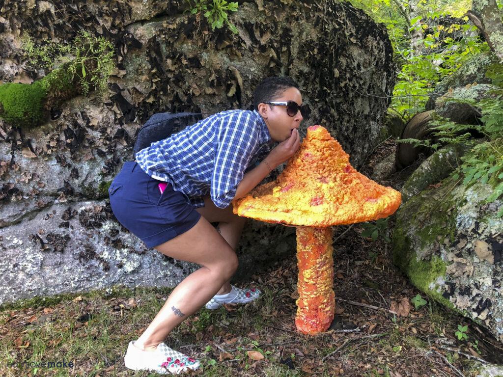 lady pretending to nibble on mushroom