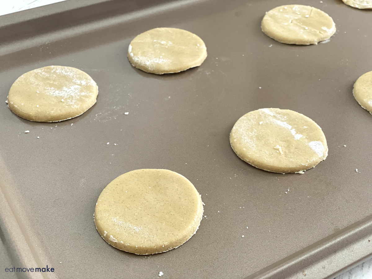 round dough roll-outs on baking sheet