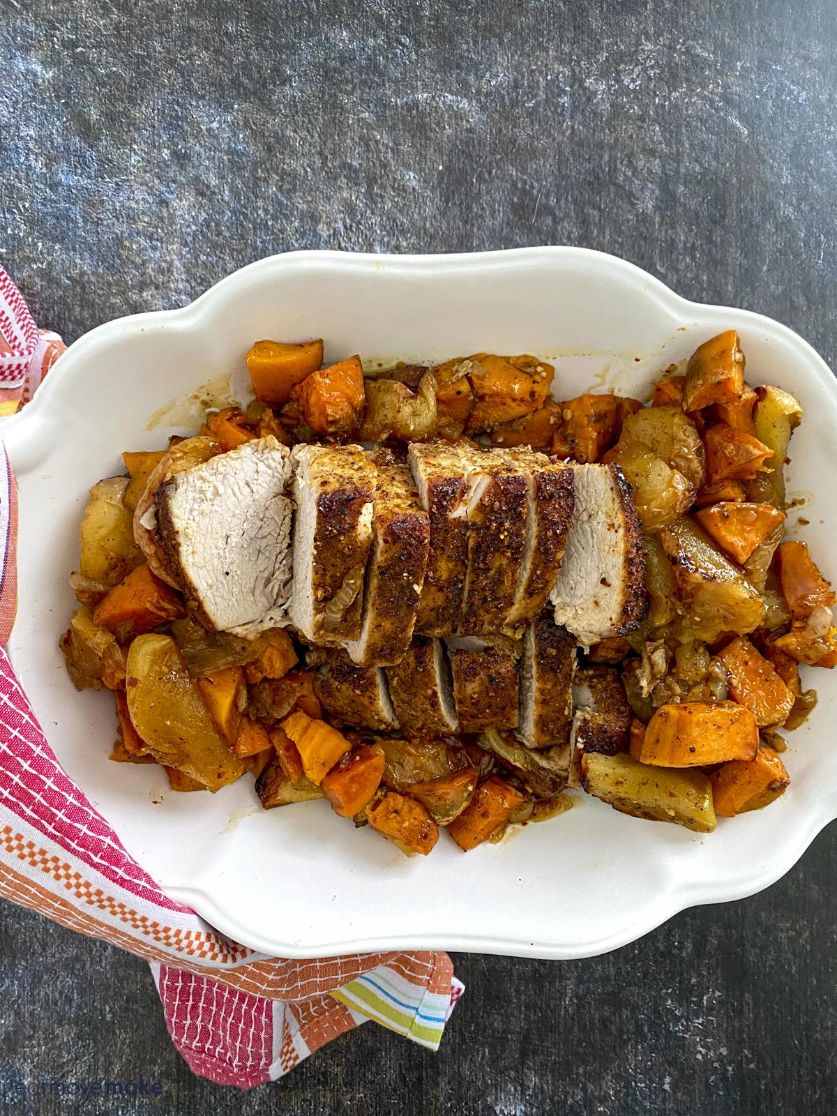 bourbon seasoned pork tenderloin with veggies in white serving dish