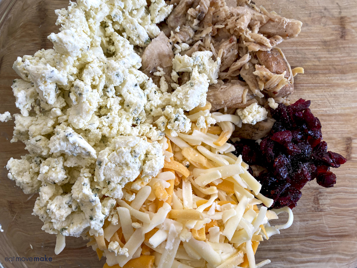 cheese, Boursin, chicken and dried cranberries in mixing bowl