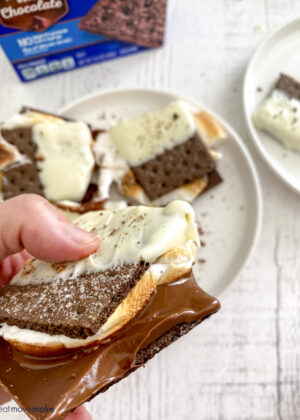 chocolate oozing from side of black and white s'mores
