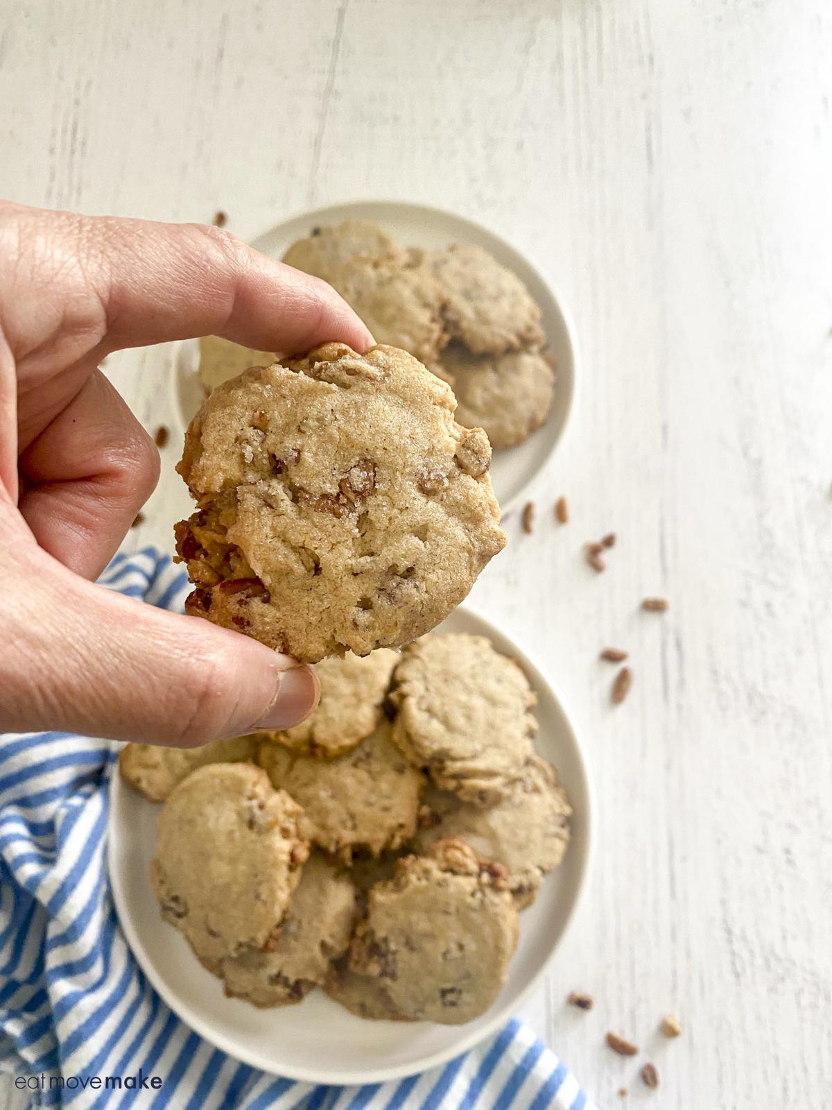 hand holding pecan cookie