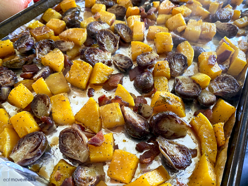 roasted squash and brussel sprouts on foil-lined baking sheet