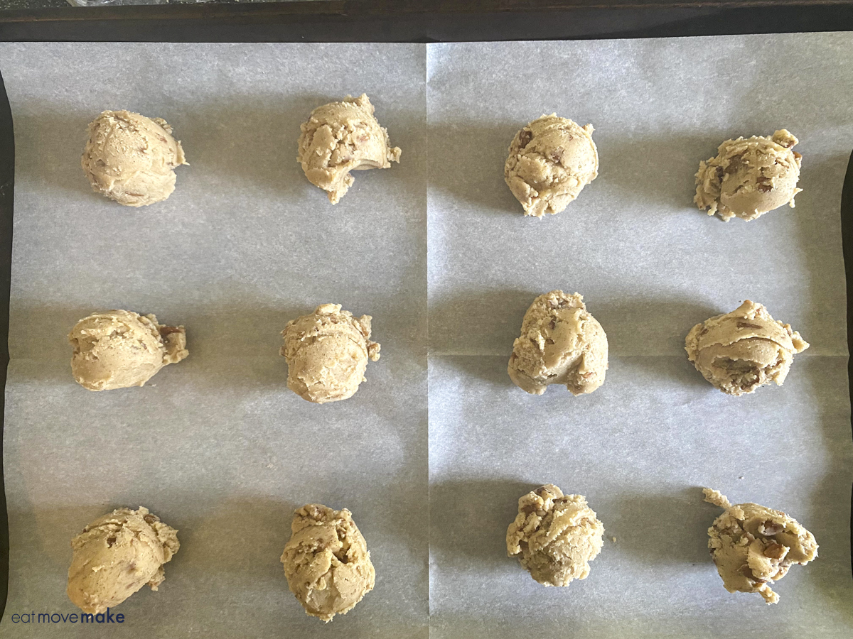 scooped cookies on parchment paper