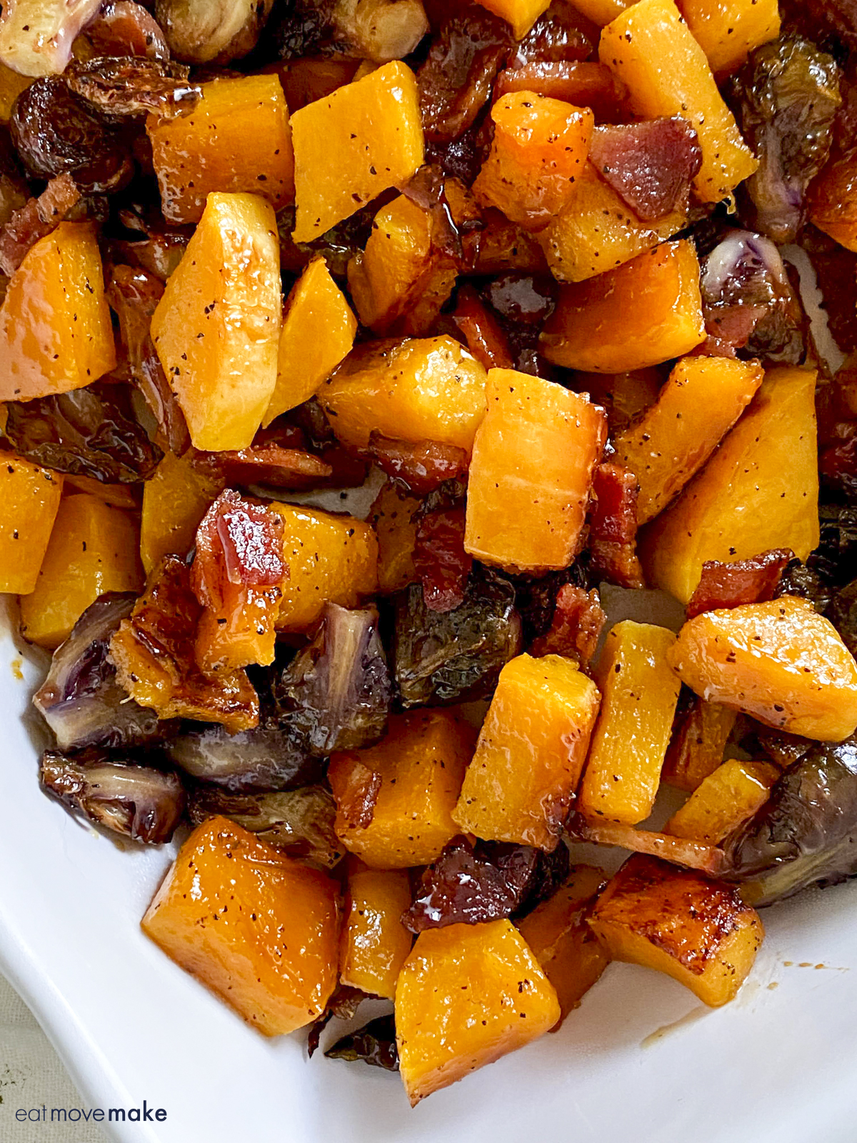 serving dish with bacon, squash and brussels