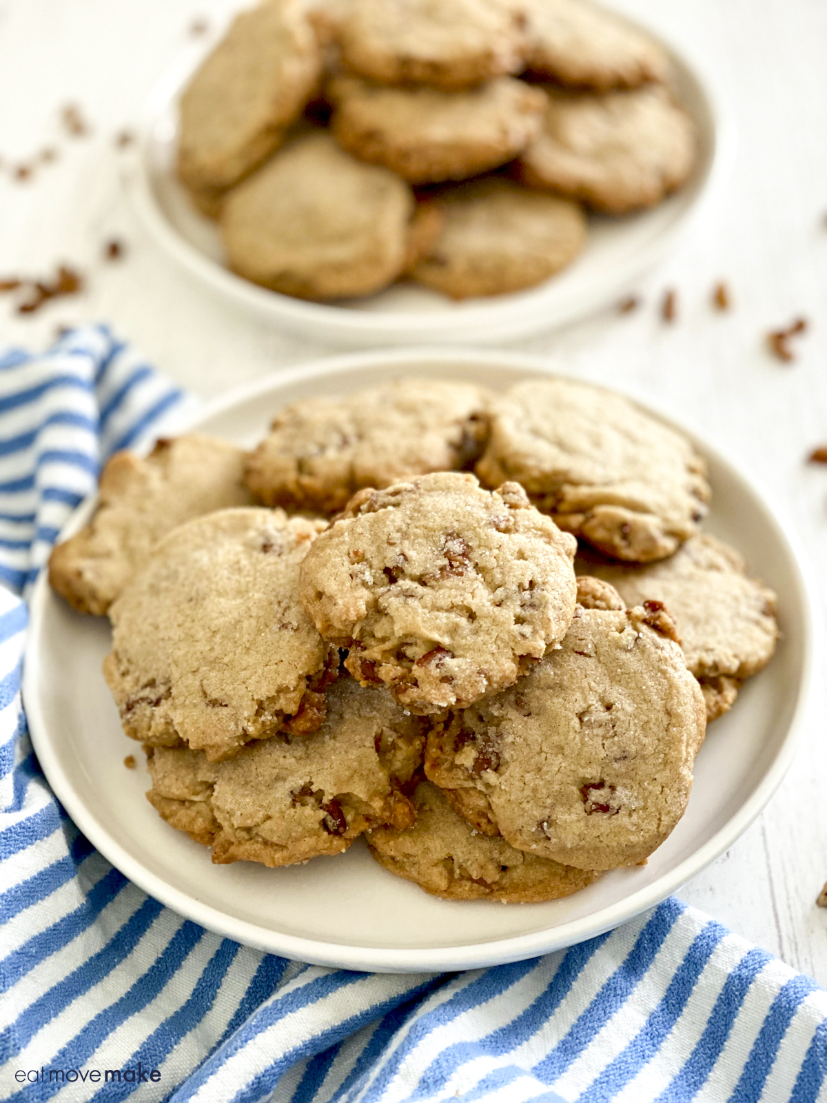 shortbread cookies with pecans on white plate