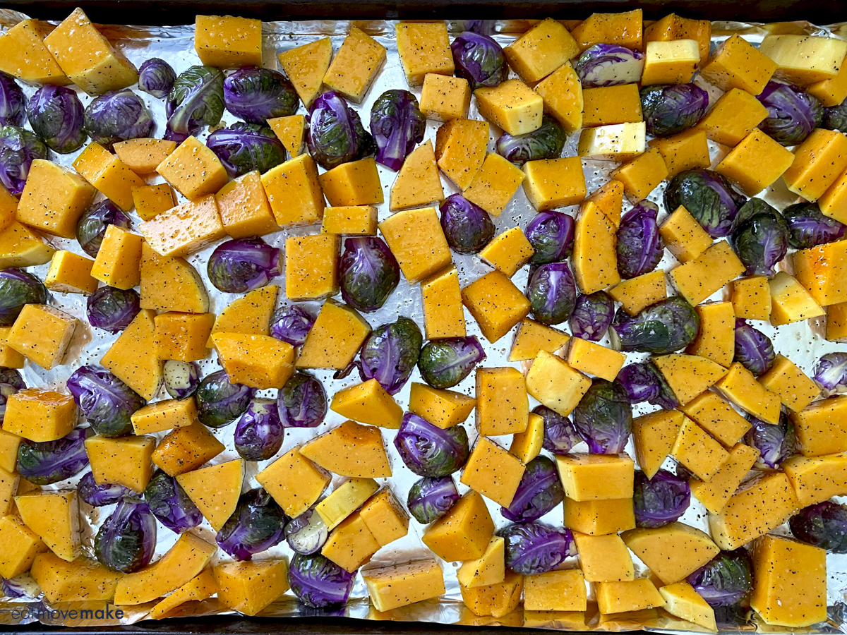 squash and brussels sprouts on foil lined sheet pan