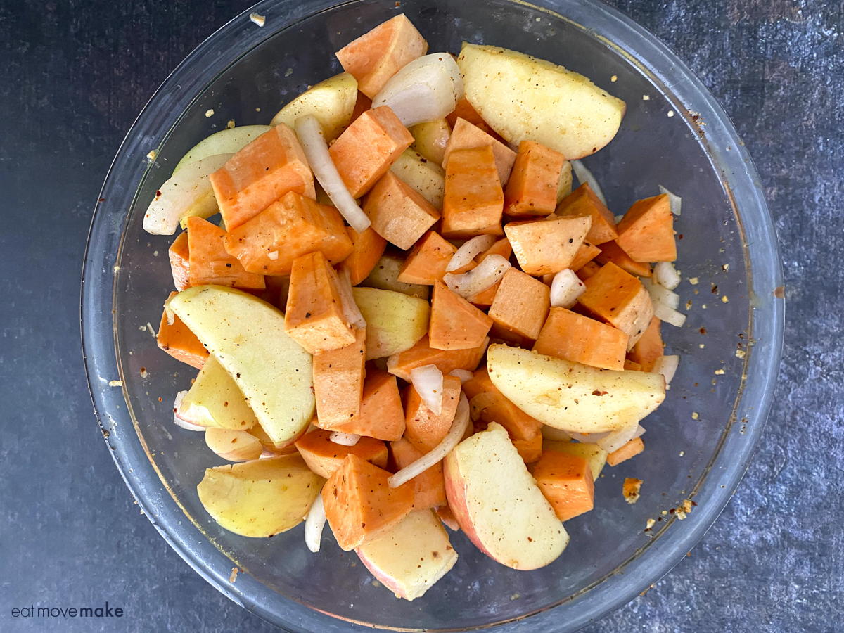 sweet potatoes, apples and onions in clear bowl