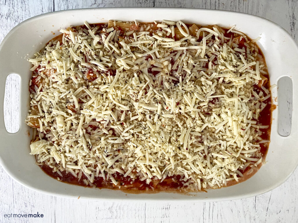 Pepper Jack cheese sprinkled over mozzarella cheese, sauce and pasta