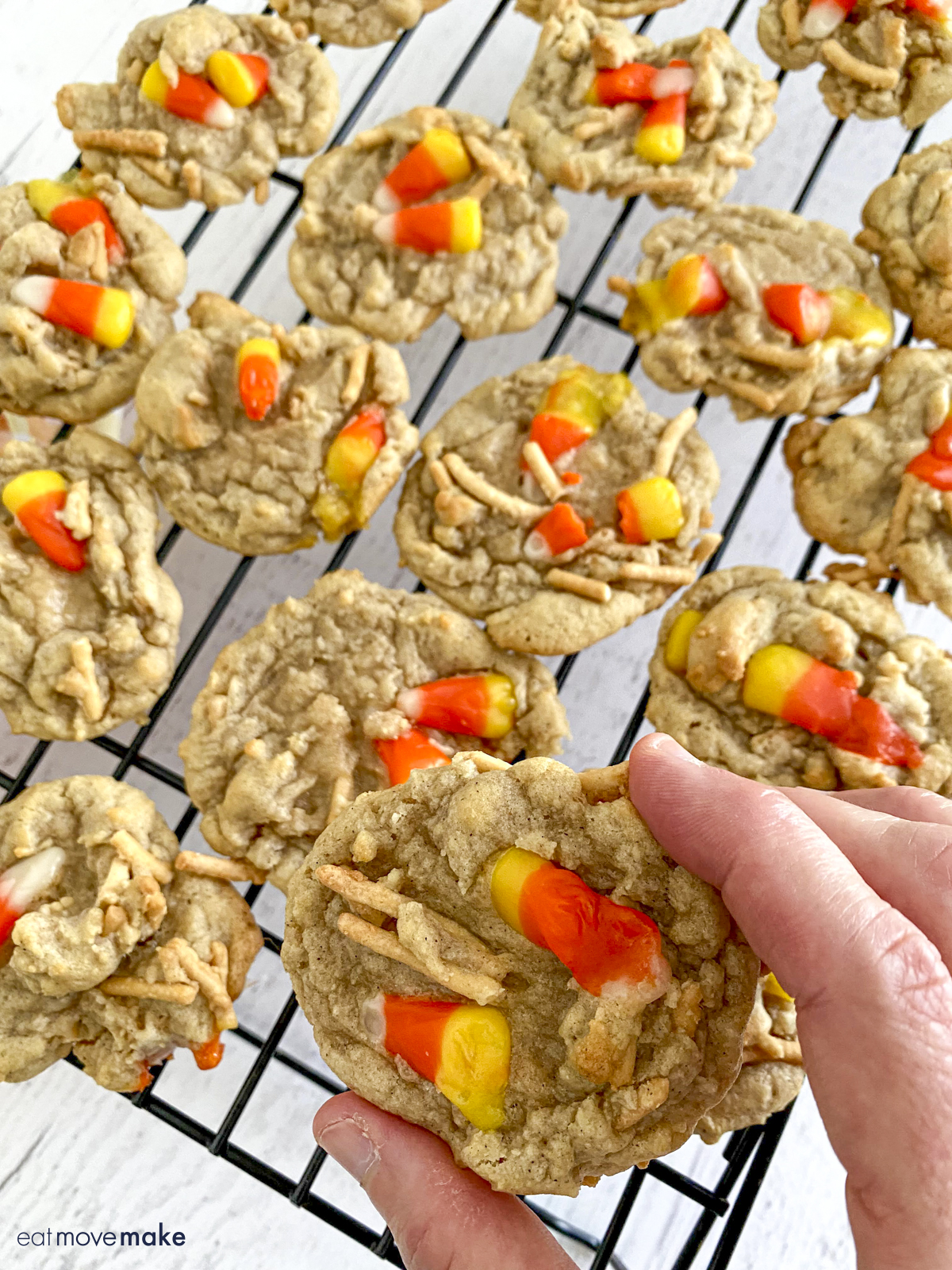 hand holding candy corn cookie