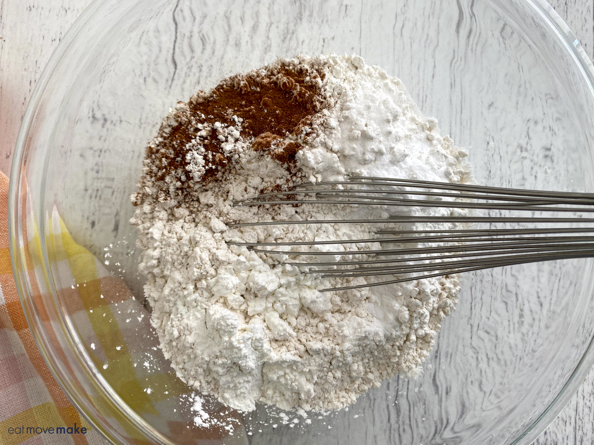 whisking flour and spices in bowl