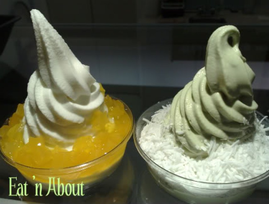 Blueberry World: Sweet Mango Star Jelly on Original flavor yogurt and Green Tea yogurt with Coconut flakes