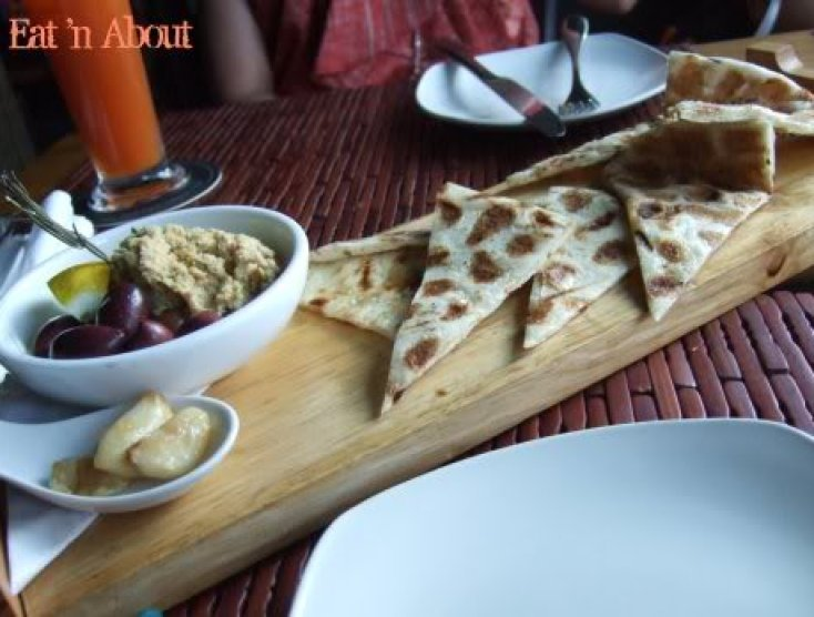 Sanafir: Naan Bread And Hummus with garlic confit and mixed olives