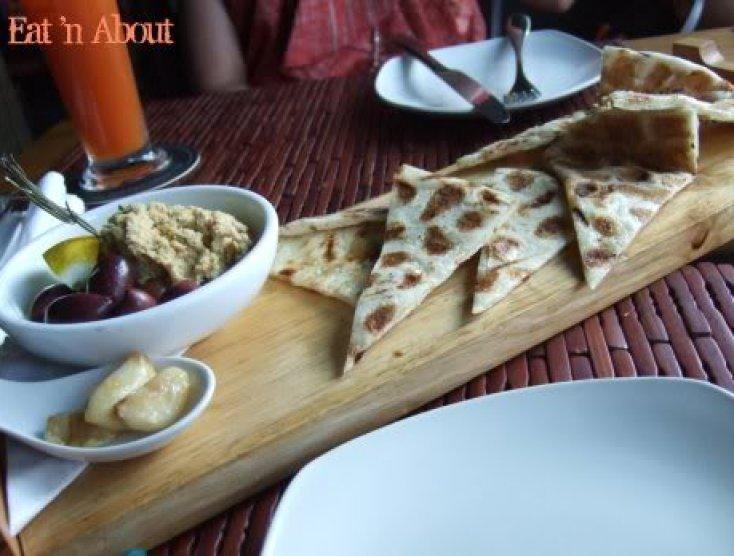 Sanafir: Naan Bread And Hummus with garlic confit and mixed olives