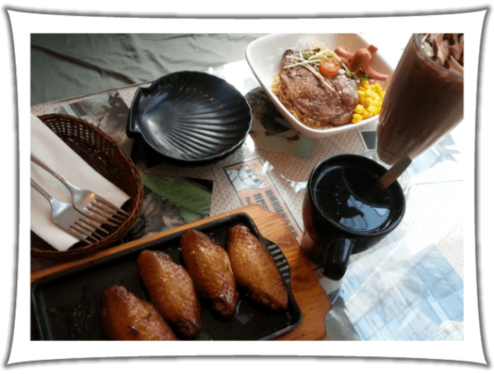 Marinated Chicken Wings, Dry Mixed Instant noodle with Pork chop and sausage, chocolate milk soda and yuzu tea at Ah Meow Choco Cat Cafe