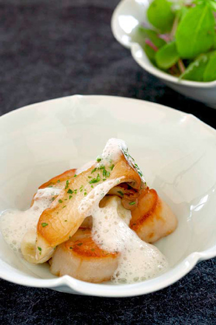 Seared Maine scallops and soba gnocchi with Trumpet Royale, celery root-Parmesan foam at Takashi Credit: Takashi Restaurant