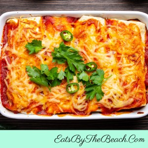 Gorgeous pan of homemade, beefy truckstop enchiladas and covered with a gooey layer of cheddar cheese. Comfort food at it's best.