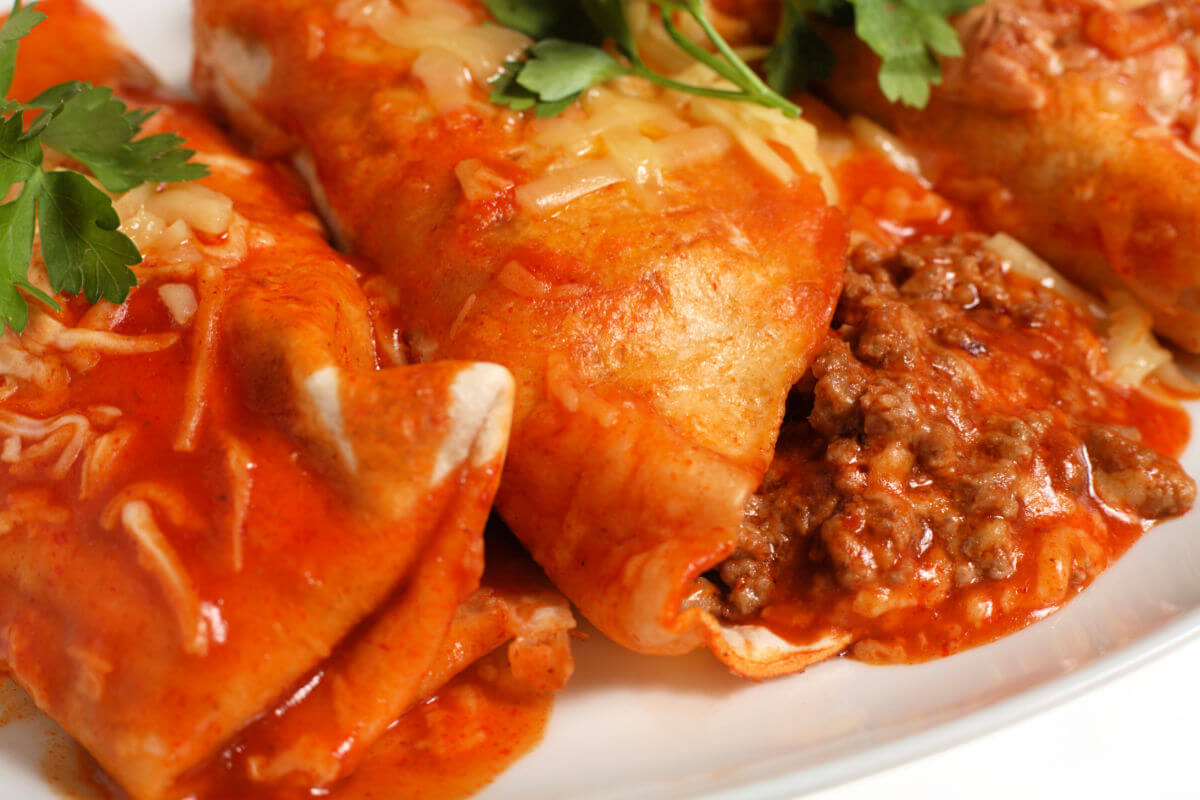 Closeup of Truckstop Enchiladas on a white plate.