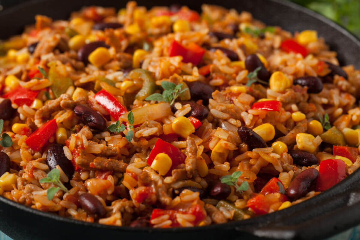 Close-up of Spicy Mexican Rice Pilaf - spicy rice, black beans, corn, and peppers in a savory chili sauce.