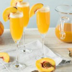 Bellini cocktail made with fresh peach puree and prosecco in a stemmed champagne flute