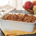 Crusty french toast casserole in a white baking dish