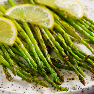 Beautiful roasted asparagus with lemon, garlic and parmesan cheese.