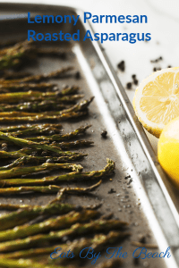 Baking pan of roasted asparagus with lemon, garlic and parmesan.