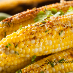 Roasted corn slathered with butter, mayo, Mexican spices, lime and cilantro