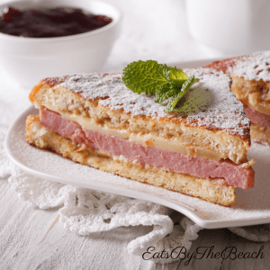 A breakfast sandwich, battered and grilled Monte Cristo Sandwich