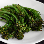 Serving plate of easy sauteed garlic broccolini with butter and red pepper flakes.