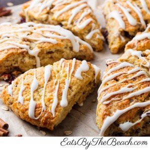 A scone made with oatmeal, dried cranberries, and pecans with a vanilla glaze. Its a perfect grab and go breakfast.