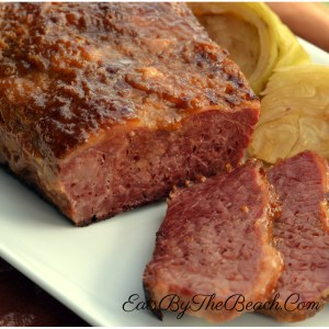 A platter of oven baked corned beef with roasted cabbage slices - A St. Patrick's Day Favorite