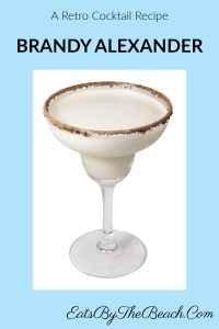 A beautiful cocktail glass with a retro cocktail. This Brandy Alexander is made with brandy, dark creme de cacao, and heavy cream. Garnished with a rim of cocoa powder and nutmeg, this is a perfect after dinner drink.
