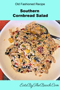 An old fashioned recipe for Southern Cornbread Salad with cornbread, black beans, jalapeno, tomatoes, red pepper, cheddar cheese, and homemade ranch dressing.