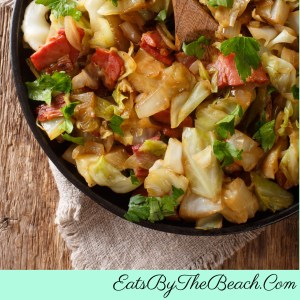 A skillet of old fashioned fried cabbage with bacon, onion, garlic, and a bit of vinegar and brown sugar.