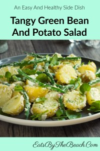 A healthy and easy side dish, a plate of tangy, green bean and potato salad with a mustard based vinaigrette and garnished with microgreens.