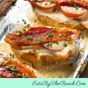 An iconic Kentucky Hot Browns sandwiches - open-faced turkey sandwich with tomato, Mornay sauce, and bacon. Perfect for a Kentucky Derby party!