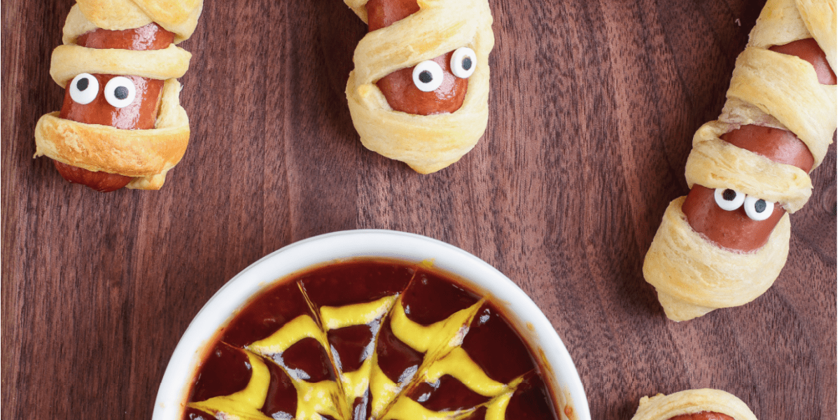 MUMMY HOT DOGS WITH SPIDER WEB SAUCE