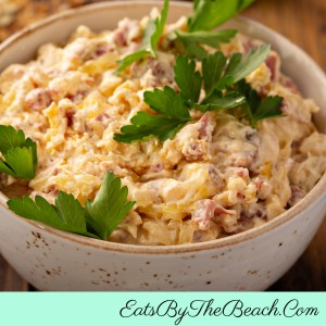 A bowl of Game Day Reuben Dip - all the flavors of your favorite deli sandwich in a delicious dip!