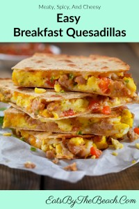 A plate of Easy Breakfast Quesadillas with scrambled egg, sausage, scallions,  red bell peppers, and cheddar cheese.