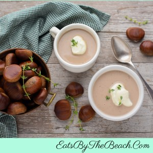 2 mugs of Creamy Italian Chestnut Soup With Parmesan Crema - a rich, decadent Thanksgiving starter or side dish.