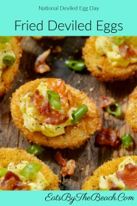 Fried deviled eggs - egg whites that are breaded and fried, then filled with deviled egg yolk and garnished with bacon and scallions.