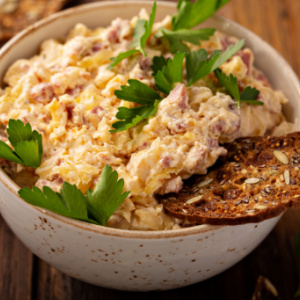 Bowl of Game Day Reuben DIp. All the flavors of your favorite deli sandwich in a dip.