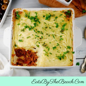 Pan of comforting Shepherd's Pie - ground beef and vegetables in sauce and topped with mashed potatoes in a casserole