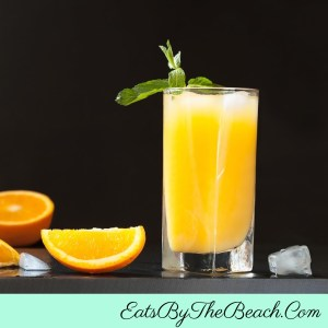 Glass of Orange-Lemon Vodka Punch - a citrus punch, much like Reymer's Lemon Blennd mixed with vodka and soda.