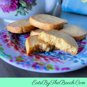 A plate of Southern Cheese Squares - cheesy, buttery slice and bake savory shortbread crackers.